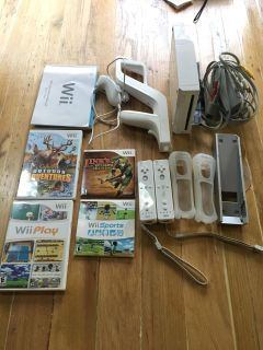 Wii Console, games, 2 controllers, bow, grips, manuals etc