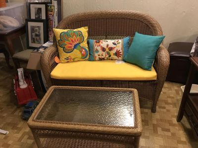 Mint condition indoor outdoor wicker furniture. Includes couch coffee table and matching chair