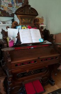 Antique pump organ and bench