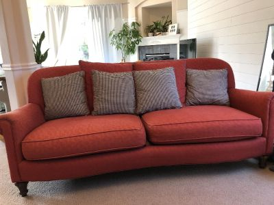 Custom made red couch with coordinating pillows