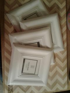 "Set of 4 white 3.5"" frames with white bow hangers"