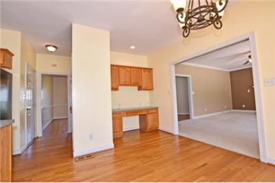 Hardwood floors greet you in the foyer from the front porch. 2 Car Garage!