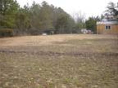 Cleared Commercial Lot Partially Fenced. Loca...