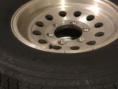 Set of 7 trailer aluminum rims and tires