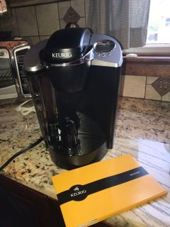 Keurig coffee maker perfect condition! Used a hand full of times was in a basement for entertaining