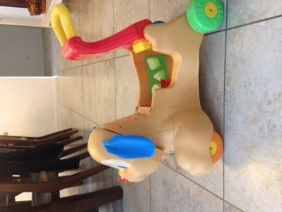 Fisher price laugh and learn ride to stride