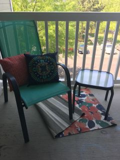 Patio chair, table, rug and pillow