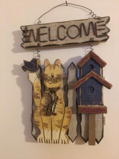 Wooden cat welcome sign