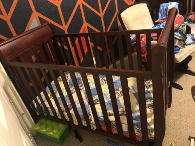 Baby crib with mattress and toddler bed conversion kit