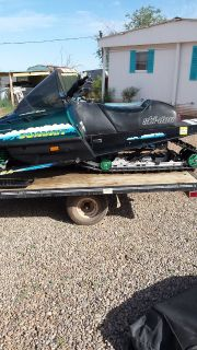 2 snowmobiles with trailer