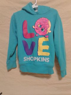 Girls Shopkins shirt with hood. Size 5. Meet in Angleton.