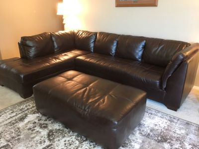 Faux dark brown leather 2 piece couch with ottoman