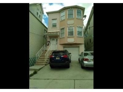6 Bed 4 Bath Foreclosure Property in Harrison, NJ 07029 - Sherman Ave