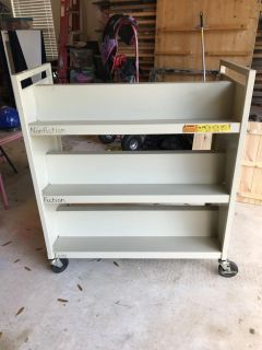 Rolling metal bookshelves cart from school library