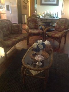 Wicker furniture two chairs coffee table and a settee excellent shape indoor outdoor
