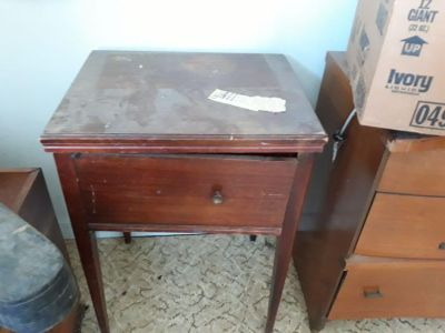 Vintage sewing machine and cabinet