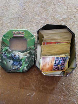 200 Pokemon cards and collector tin.