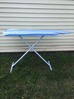 Like new ironing board with two covers