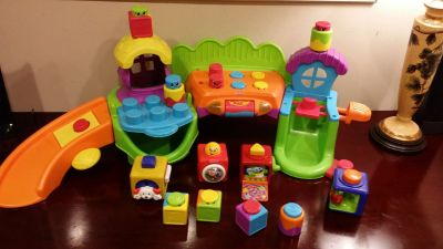 Fisher Price activity center with stackable and pop up toys, with music