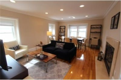 Spectacular renovated top floor of 3-family in the