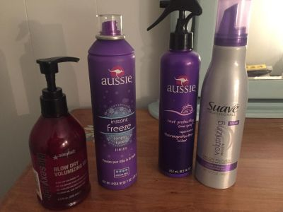 Hair lot. 2 on right brand new never used. The Aussie instant freeze apprx 1/2 full & sexy hair blow drying gel is more than 3/4 all 4 $8