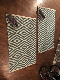 2 small teal and white rugs-shoe for size comparison