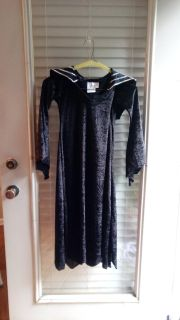 Lightweight knit black witches dress w/detachable rhinestone cobweb. Girls size 8-10. Excellent, like new condition.