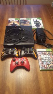 Xbox 360 with 3 controllers and 4 games
