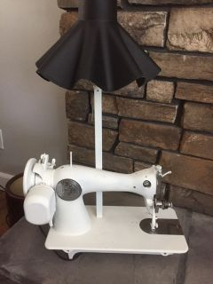 Vintage singer Sewing machine light. Cool piece. Asking $40. One of a kind.