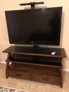 Wooden entertainment center with FREE TV included