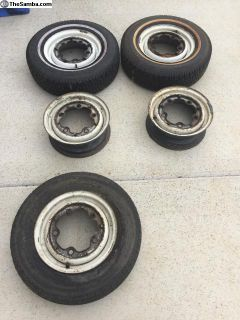 5 14 bus wheels, 2 mounted with studded tires