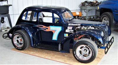 HISTORIC LEGENDS RACE CAR with NASCAR background