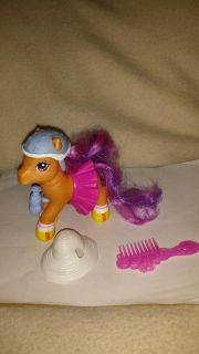 My little pony with helmet, fancy skirt, water bottle, brush, and a extra hat.