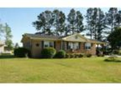 1.0 acre of country paradise to enjoy while s...