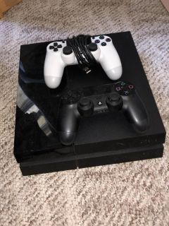 PlayStation 4 PS4 Console with 1TB with 2 controllers and 2 games
