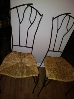 2 Cafe Chairs with Unique wrought iron design and Unique seat