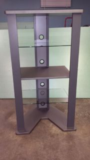 beautiful corner entertainment ccenter with glass shelves