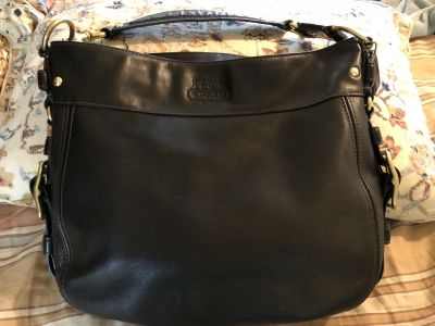 Very nice black leather COACH purse with gold hardware. Pretty purple interior.
