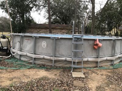 Swimming pool with sand filter pump