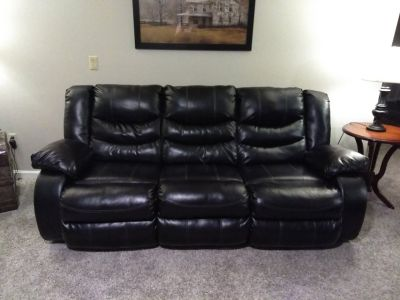 Black leather reclining sofa and loveseat set