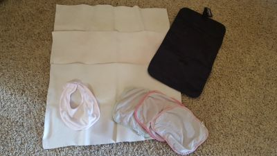3 Baby Travel Spill Pads, 3 Wash Cloths, 1 Bib, 1 Changing Mat