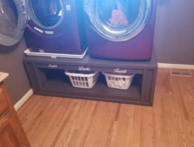 Hand built laundry riser for front load washer and dryer