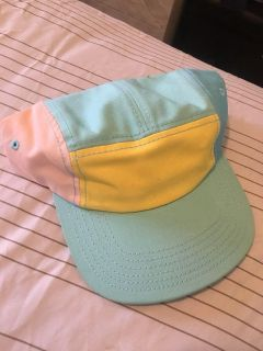 Teal, yellow and white cap