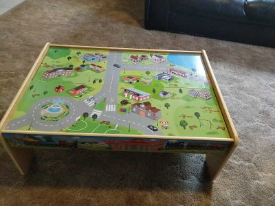 Wooden train table with accessories