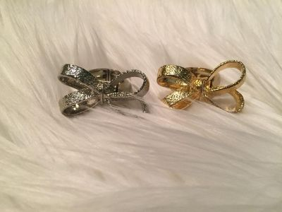 New! Never worn! Gold & Silver Bow Rings w/Stretch bands. $3 each or both for $5. Scroll for all pics.