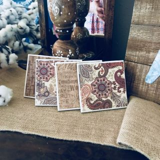 Set of four (4) ceramic coasters, two paisley, one with the names of Jesus, one with crosses, neutral tones. Giftable!! Only $10!