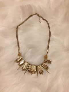 Gold colored statement necklace