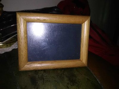 In good shape wall picture frame 5 by 7 wood