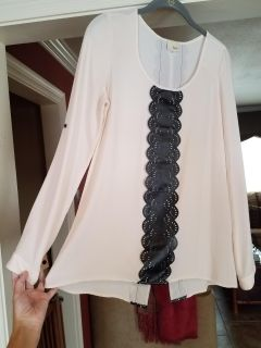 Cream blouse with black faux leather trim see back in pics. Sleeves can be worn down or buttoned up. Worn once to a Christmas Eve party.