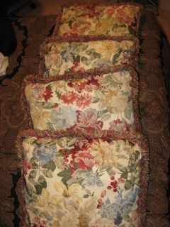 (4) flowered patterned pillows w/ decorative fringe trim